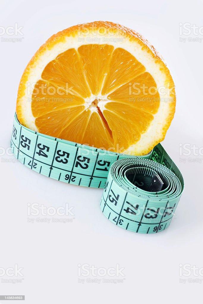 Fresh orange and measuring tap royalty-free stock photo