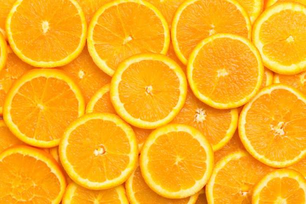 verse oranje fruitplakkenpatroonachtergrond, sluit omhoog - vitamine c stockfoto's en -beelden