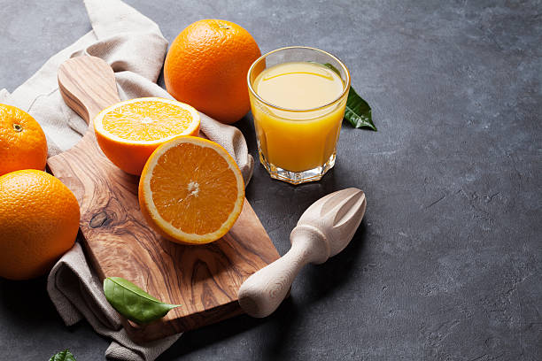 Fresh orange fruits and juice stock photo