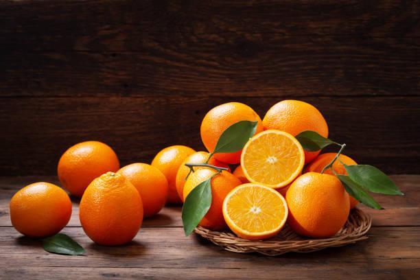 fresh orange fruits with leaves stock photo