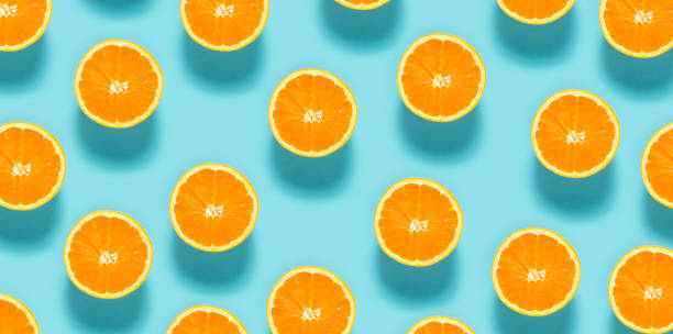Fresh orange halves Fresh orange halves on a blue background orange fruit stock pictures, royalty-free photos & images