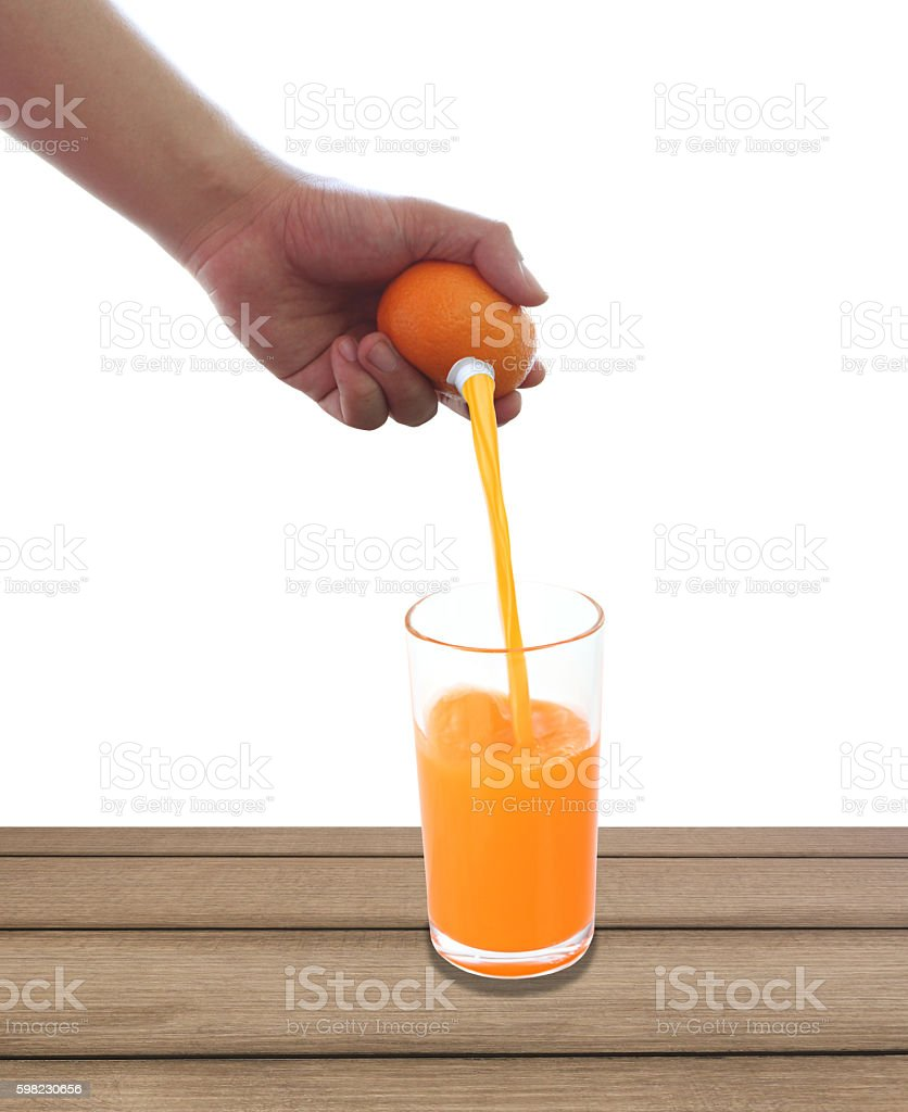 fresh orange in hand and have fruit juice. foto royalty-free