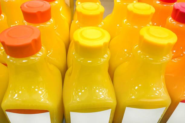 Fresh orange juice bottle stock photo