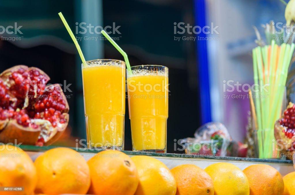 Fresh orange juice for sale in stall in Jemma El Fna square. Marrakech, Morocco stock photo