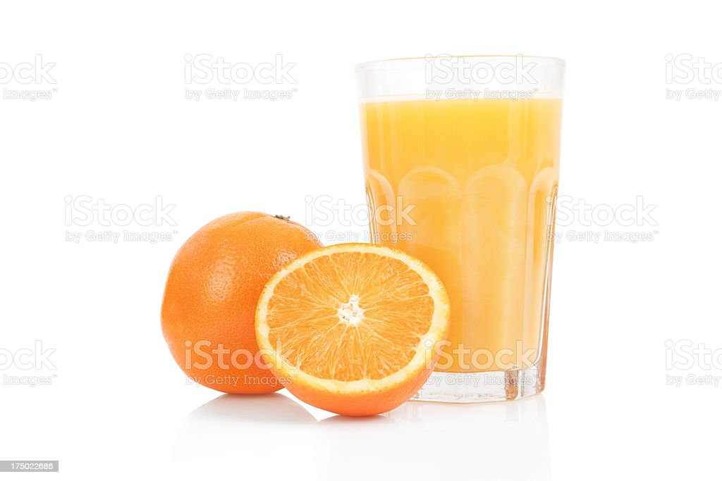 Fresh orange juice in glass cup next to a sliced orange royalty-free stock photo