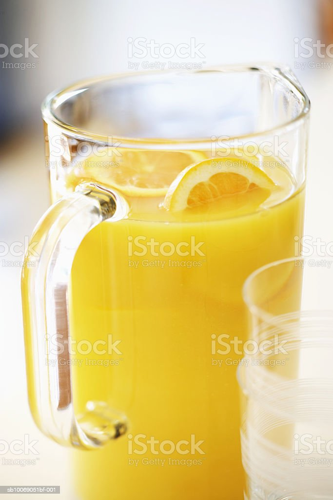 Fresh orange juice in pitcher, close-up foto de stock libre de derechos