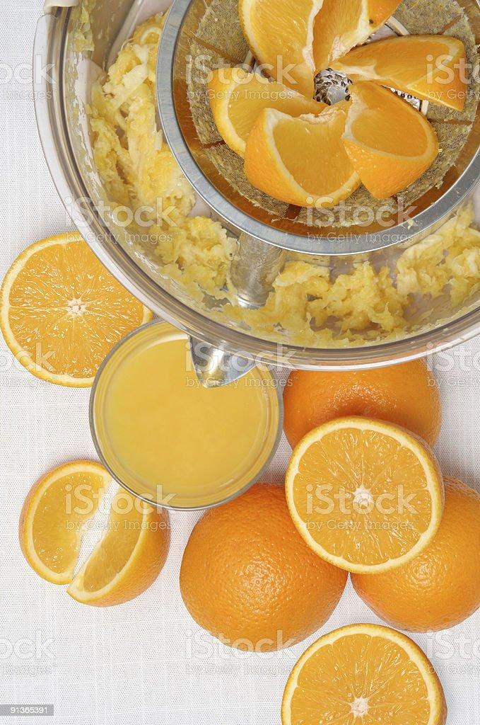 Fresh  orange juice, juicer and oranges stock photo