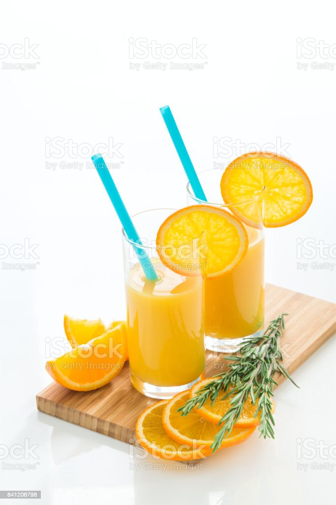 Fresh orange juice on white table stock photo