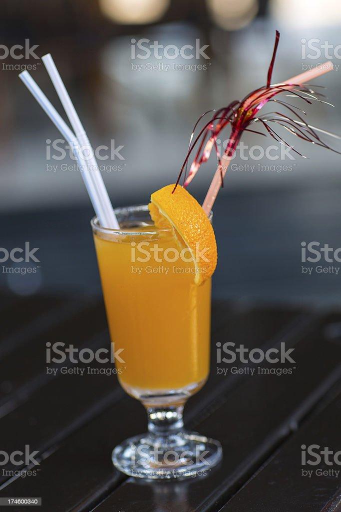 Fresh orange juice with straw on wood table royalty-free stock photo