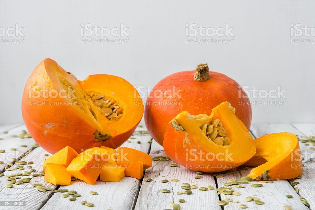 fresh orange pumpkin with seeds stock photo