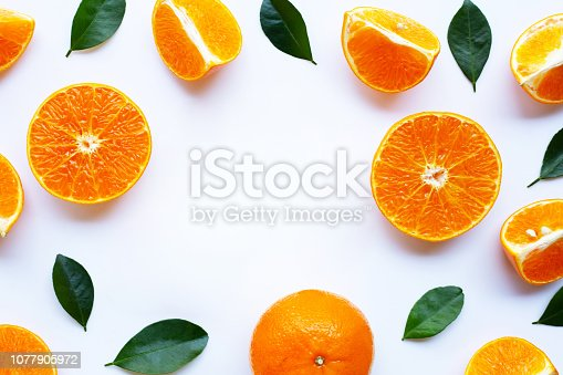 Fresh orange with green leaves isolated on white background. Copy space