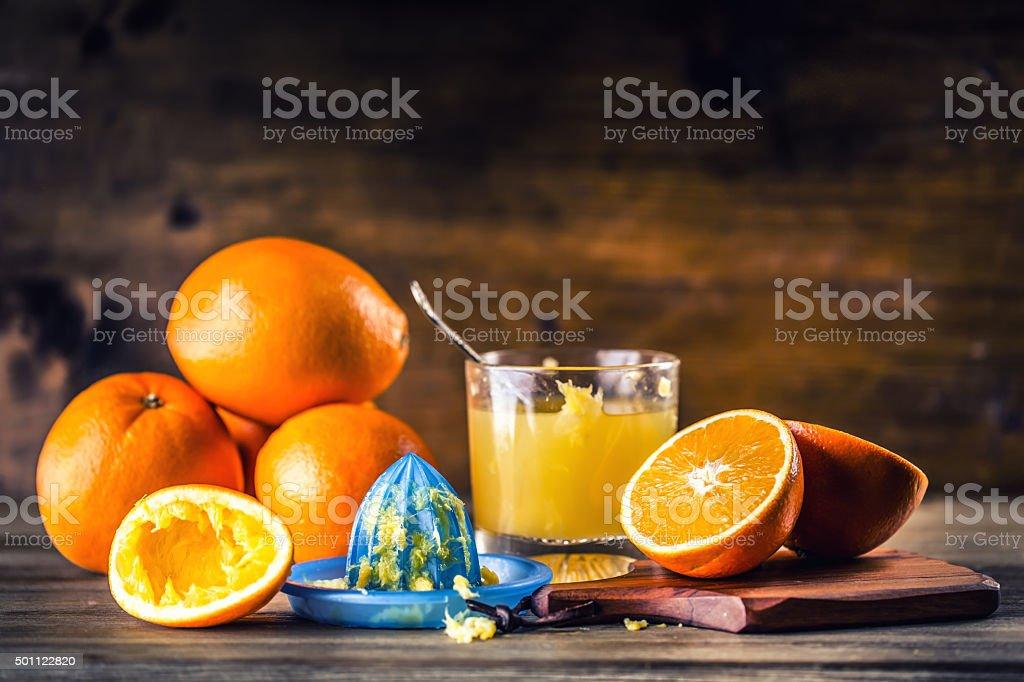 Fresh oranges. Cut oranges. Pressed orange manual method. stock photo