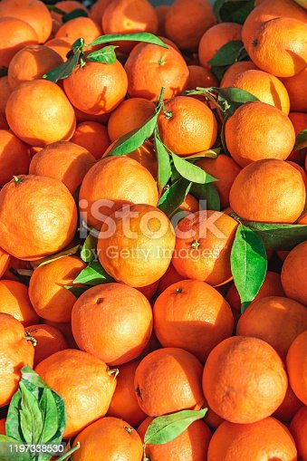 Fresh oranges on market stall at weekly spanish marketplace. Food background close up shot with selective focus.