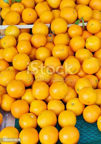 Fresh and natural oranges on market stall in Siena, Italy