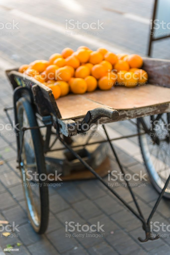 Fresh oranges on vintage wooden cart royalty-free stock photo