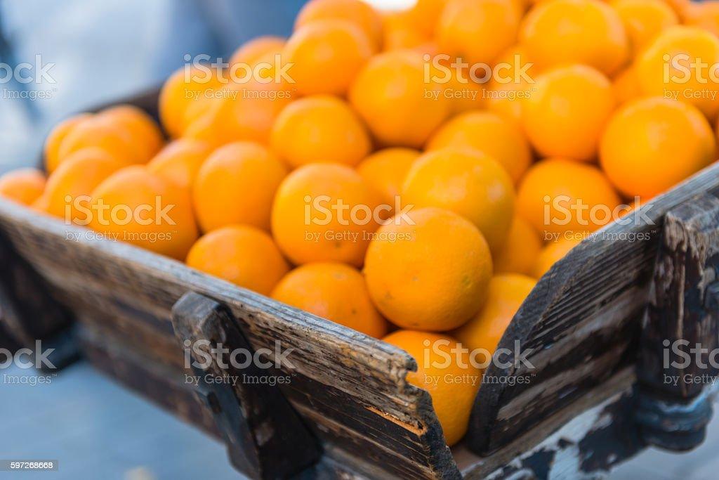 Fresh oranges on vintage wooden cart royalty-free stock photo