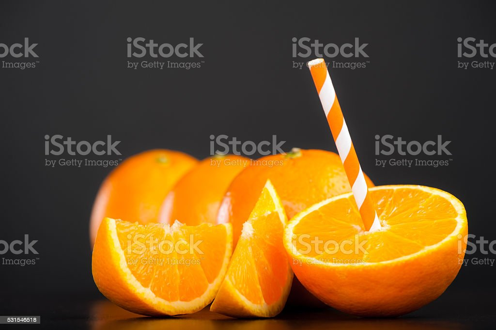 Fresh Oranges with a straw stock photo