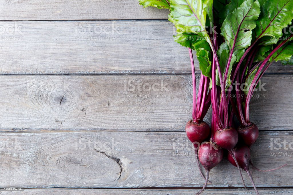 Fresh organic beet, beetroot on grey rustic wooden background. Top view. Copy space. stock photo