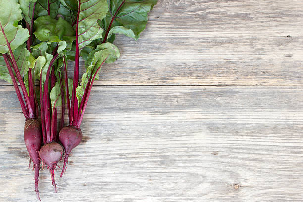 Fresh organic beet on a wood table with copy space stock photo