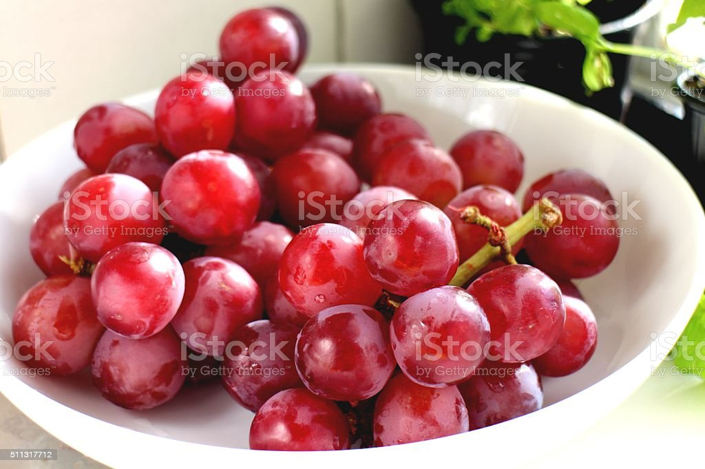 Fresh organic big red grapes stock photo