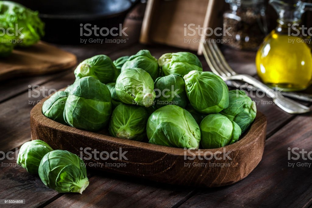 Fresh organic Brussels sprouts shot on rustic wooden table – zdjęcie