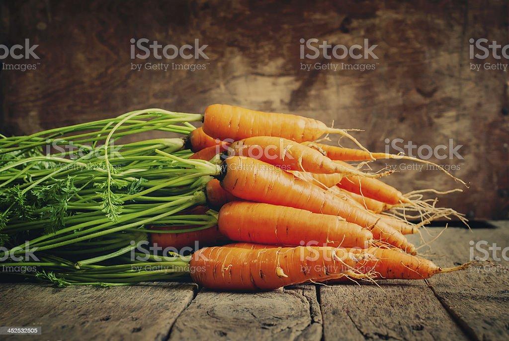 Fresh Organic Carrots lies on wooden background, horizontal, ton stock photo