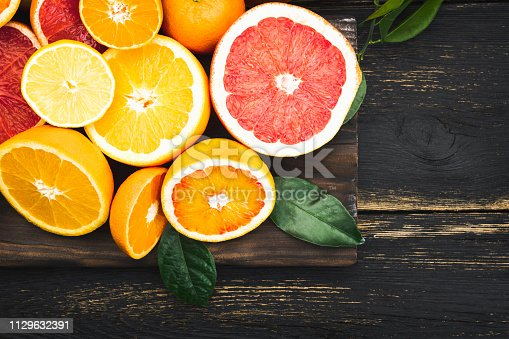 Citrus fruits on rustic wooden table