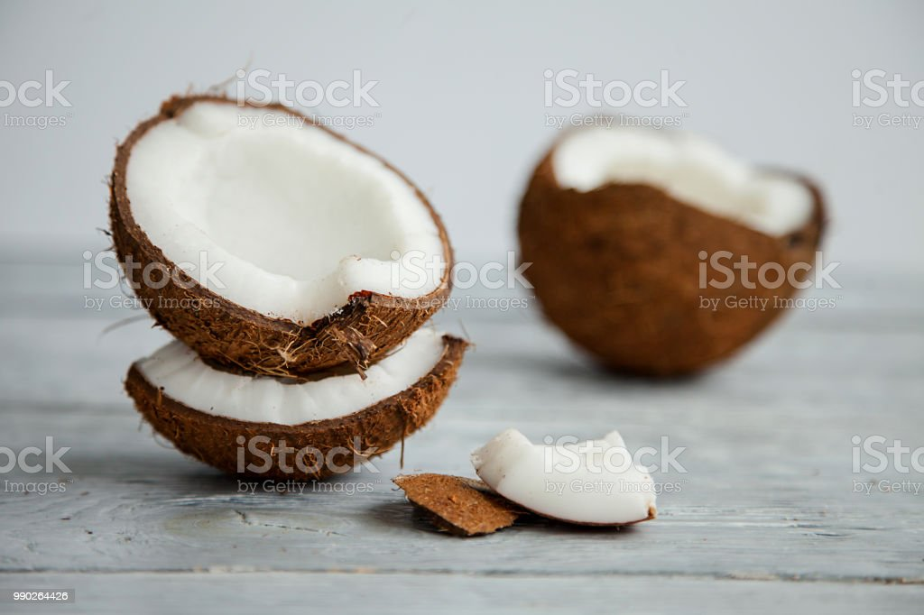Fresh organic coconut on rustic wooden background royalty-free stock photo