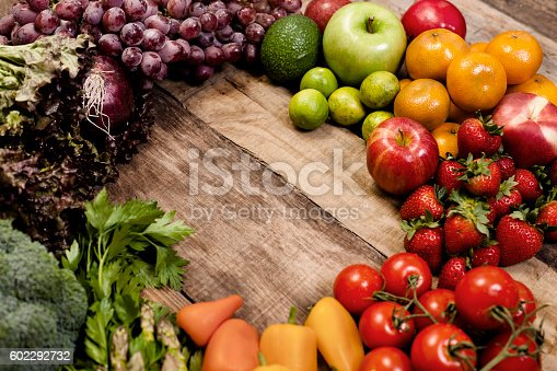 istock Fresh, organic colorful fruits, vegetables on rustic wooden table. 602292732