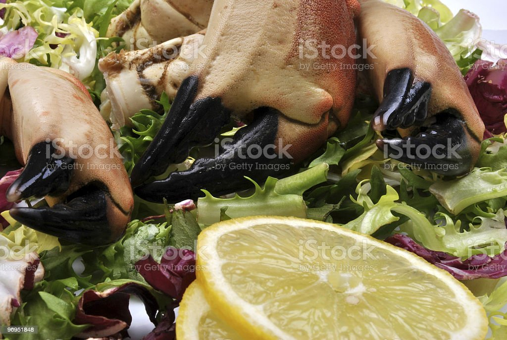 fresh organic crab claws with salad and lemon royalty-free stock photo