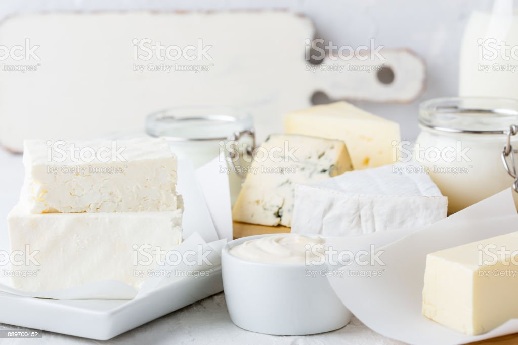 Fresh organic dairy products on white table