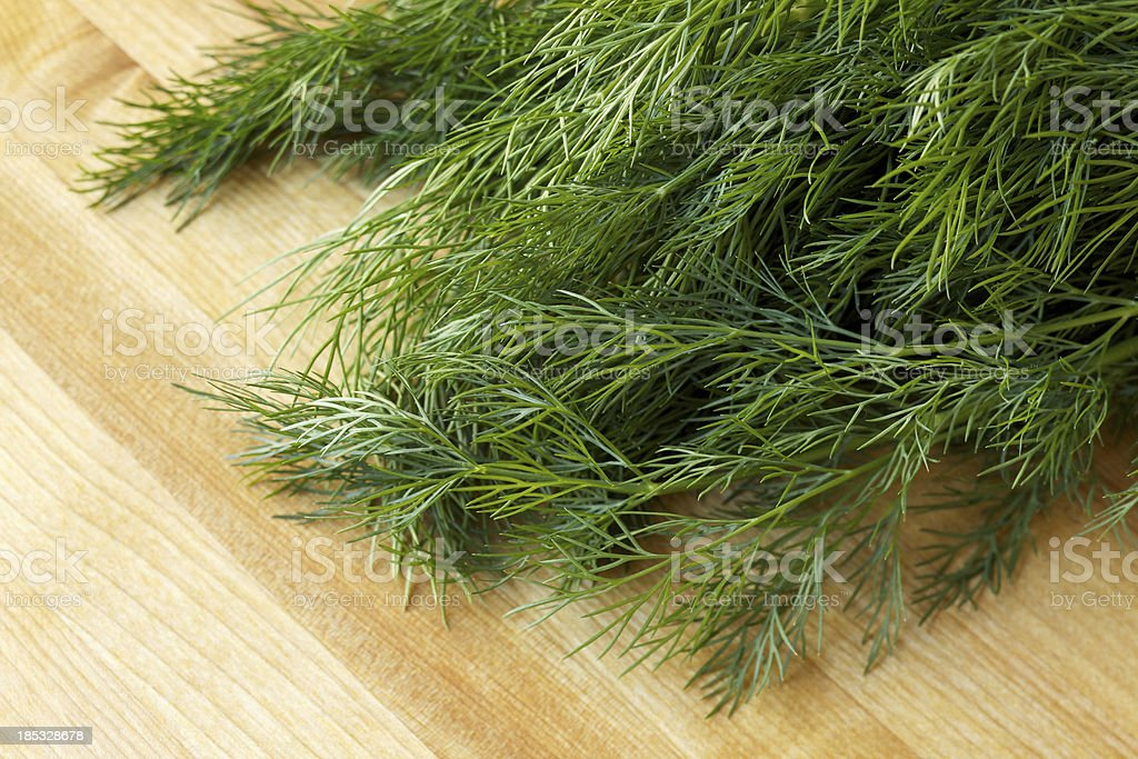 Fresh organic dill on new wood surface stock photo