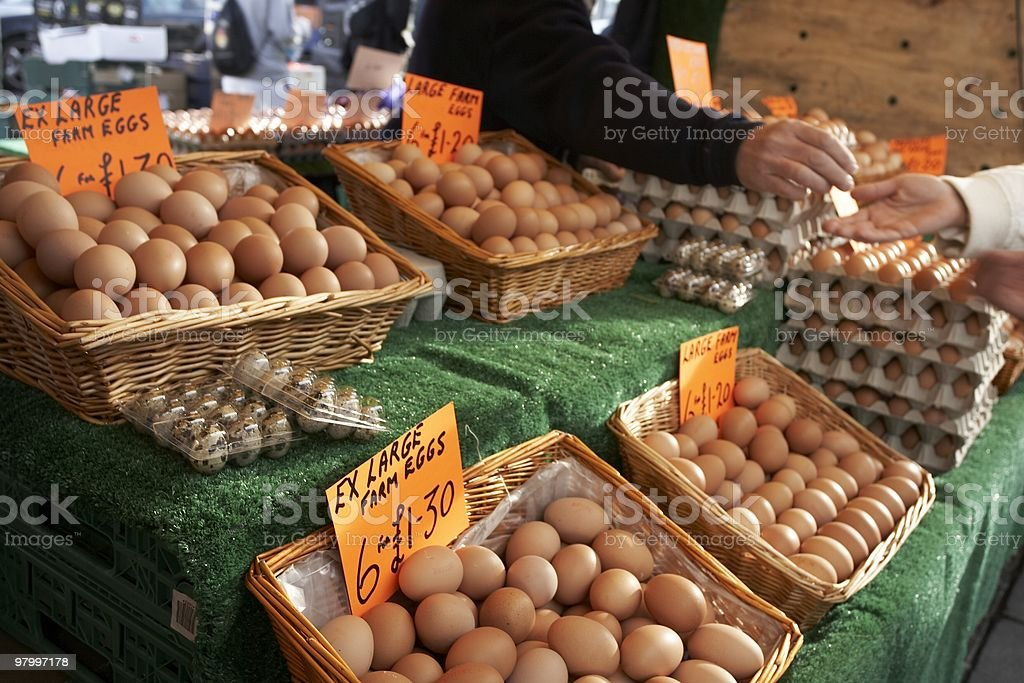 fresh organic farm eggs being sold at market royalty-free stock photo