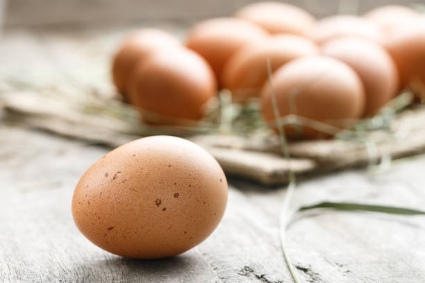 fresh organic farm eggs lie on burlap stock photo