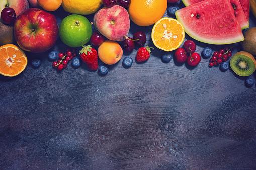 istock Fresh Organic Fruits Background 693830228