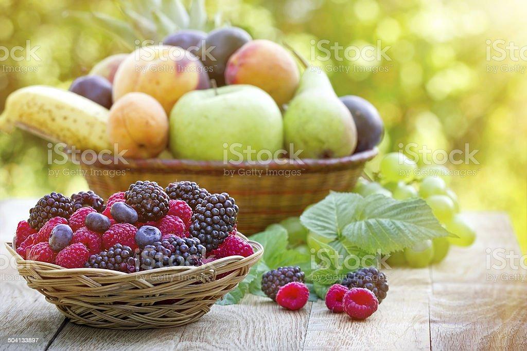 Fresh organic fruits in wicker basket stock photo