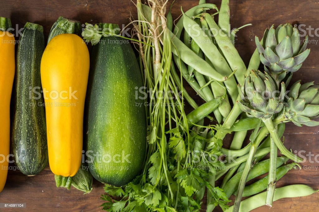 Fresh organic green vegetables on wooden floor royalty-free stock photo
