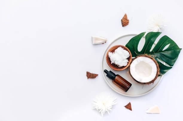 fresh organic healthy coconut butter with coconut pieces over white background - puxar cabelos imagens e fotografias de stock