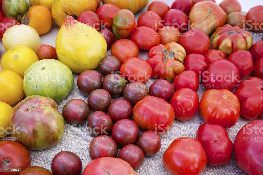 Fresh organic heirloom tomatoes at a farmers market royalty-free stock photo