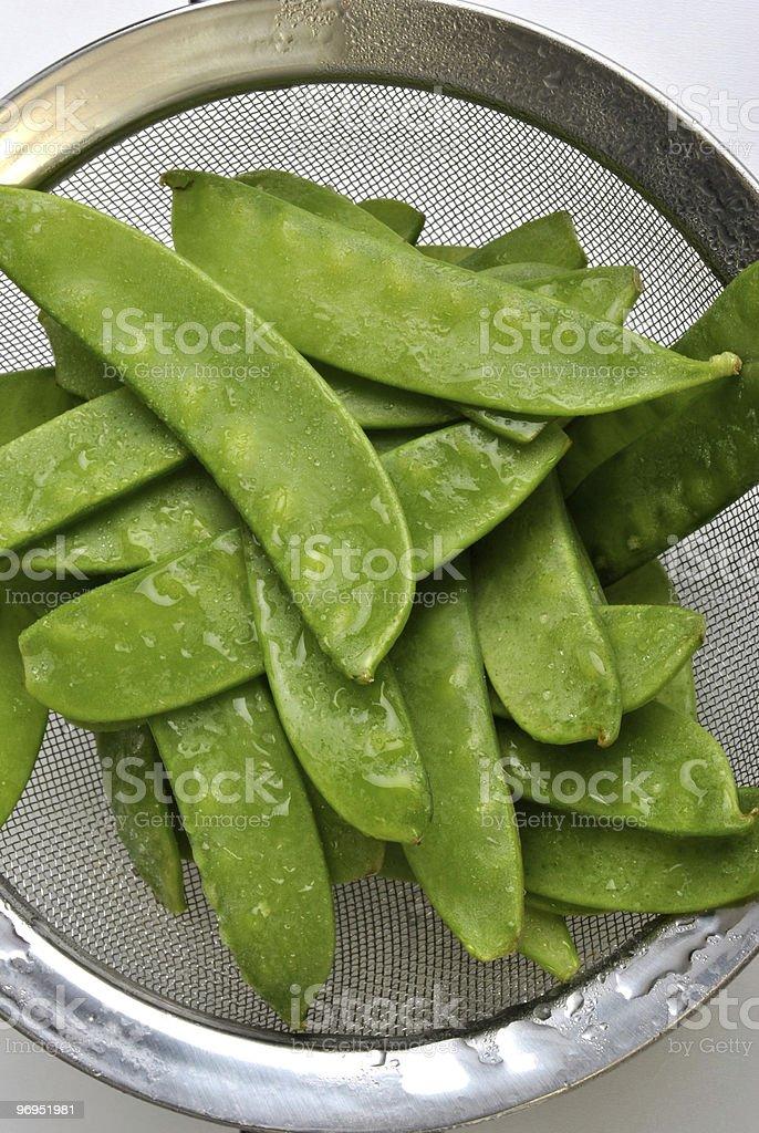 fresh organic mangetout, also known as sugar snap pea royalty-free stock photo