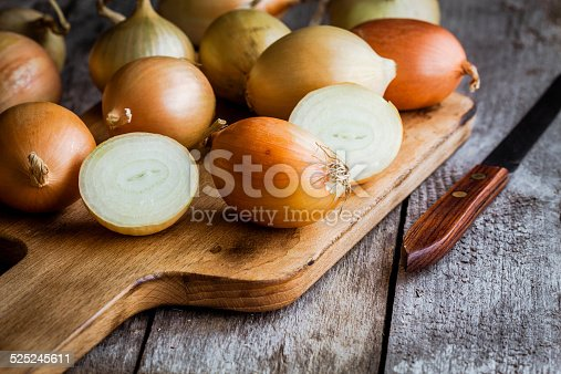 Fresh organic onions on a wooden background