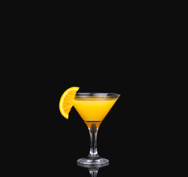 fresh organic orange juice and vodka in a tall glass  on a black background fresh organic orange juice and vodka in a tall glass  on a black background screwdriver drink stock pictures, royalty-free photos & images