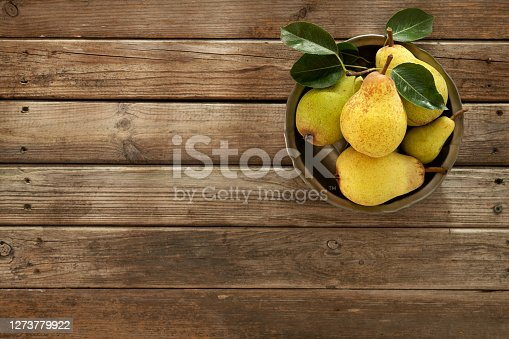 istock Fresh Organic Pears On An Old Wooden Background 1273779922