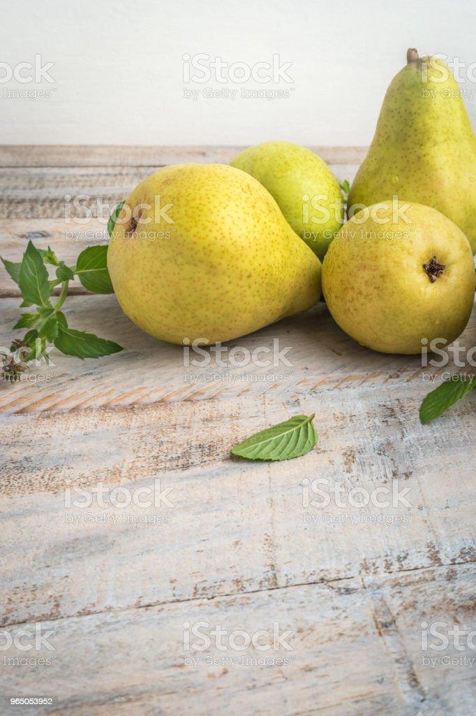 Fresh organic pears on old wood. Fruit background. Pear autumn harvest zbiór zdjęć royalty-free