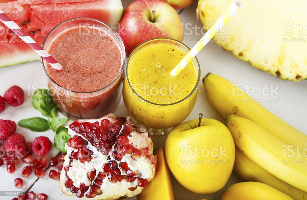 Fresh organic red and yellow smoothie with apple, watermelon stock photo