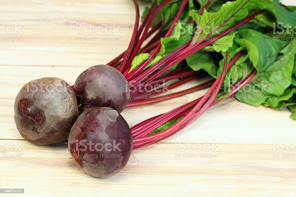 Fresh organic red beets just picked up from the garden stock photo