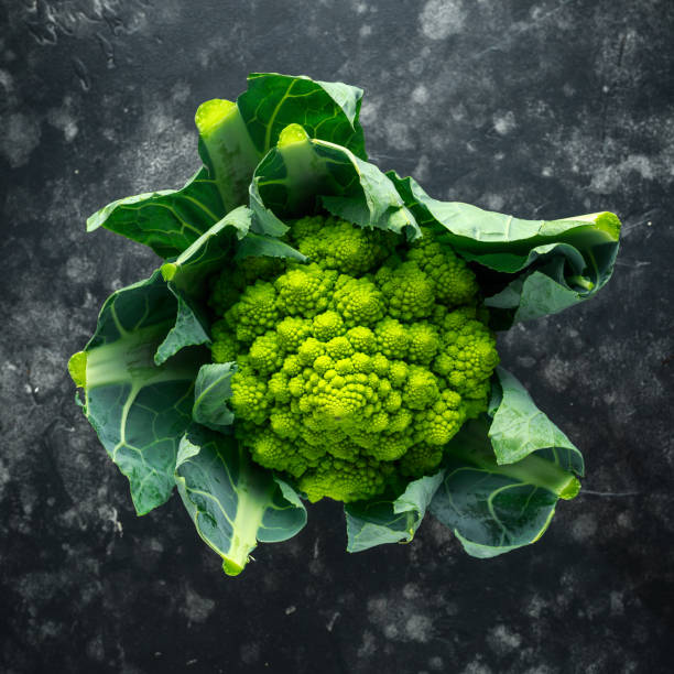 Fresh organic romanesco broccoli cauliflower Fresh organic romanesco broccoli cauliflower. romanesque stock pictures, royalty-free photos & images