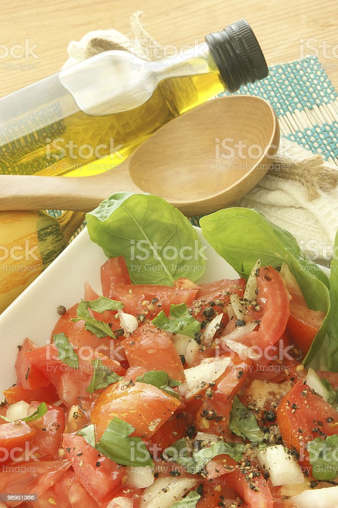 fresh  organic tomato salad with basil and onion royalty-free stock photo