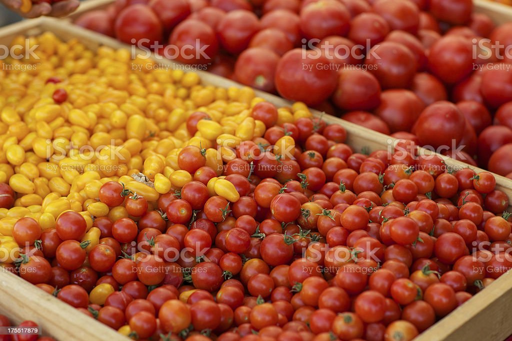 Fresh organic tomatoes at a farmers market royalty-free stock photo