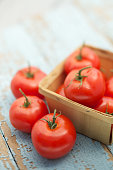 istock Fresh organic tomatoes on brown burlap 485362358